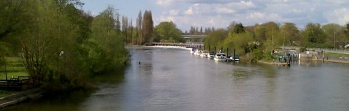 Chertsey Lock on the Thames viewed from Chertsey Bridge on a summer day